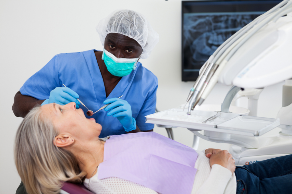https://www.shutterstock.com/image-photo/dentist-treating-female-patient-which-sitting-1378192115?src=VSjXYzRI_O-LW-4hQlQ5pA-1-12